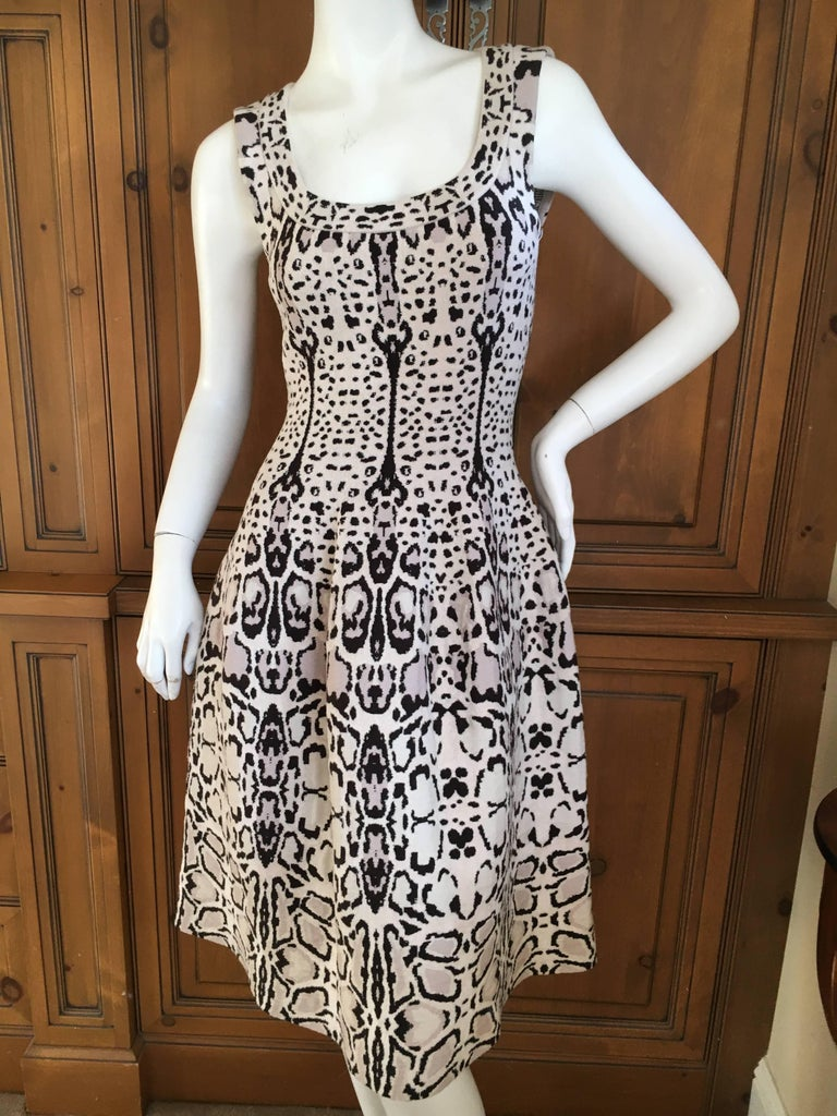 "Iconic snow leopard pattern dress from Alaia. Size 40 Unworn Zips up side. Bust 34"" Waist 27"" Hips 45"" Length 39"" 57% Virgin Wool, 22% Viscose, 13% Polyamide, 8% Polyester"