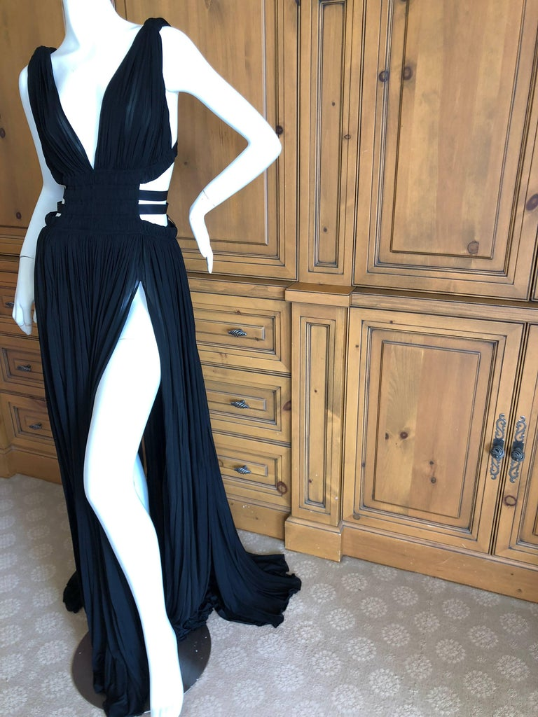 Azzedine Alaia Vintage Autumn 1991 Black Pleated Goddess Gown with side straps  Please see all the great vintage Alaia in my store. This appears to never have been worn and is extremely long  Size 40  Bust 36