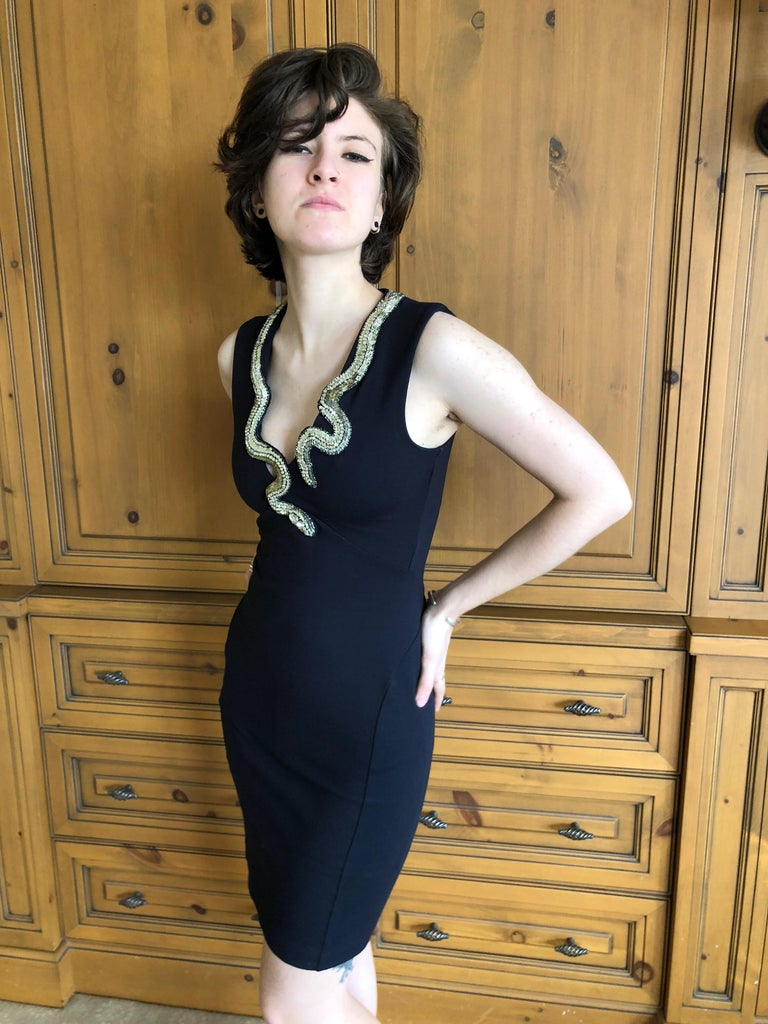 Roberto Cavalli Vintage Black Bodycon Dress with Embellished Snake Collar. Who created the first snake embellished fashion? Ask Eve This is amazing, very stretchy dress, hugs all the right places.  Size 38  Measurements given un stretched  Bust 34
