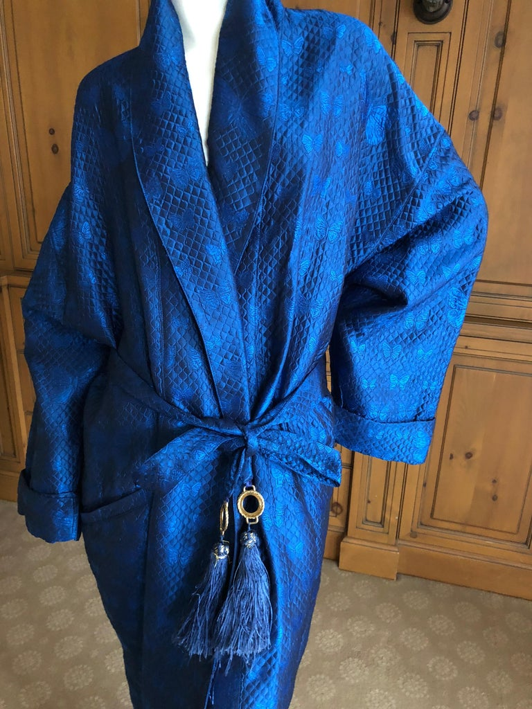 Gianni Versace Intimo 1980's Royal Blue Silk Butterfly Pattern Brocade Robe with Fringe Belt. I believe this is from the men's collection, but could work for men or woman.  There is no size label, I would say it's a XX large Measurements ;   Chest