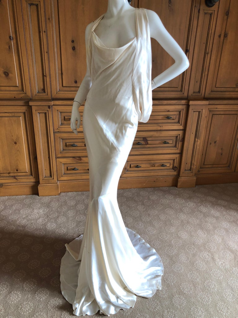 Alexander McQueen Daring Ivory Duchesse Silk Satin Evening or Wedding Dress This is so beautiful, with a full inner corset that is exposed. Size 44 seems to be cut quite generously.  Bust 38