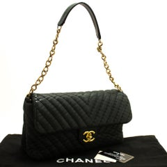CHANEL Chevron V-Stitch Chain Shoulder Bag Flap Quilted Glitter