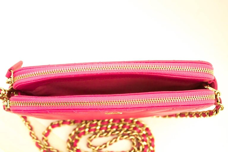 28c6ad23384f An authentic CHANEL Hot Pink Wallet On Chain WOC Double Zip Chain Shoulder  Bag The outside