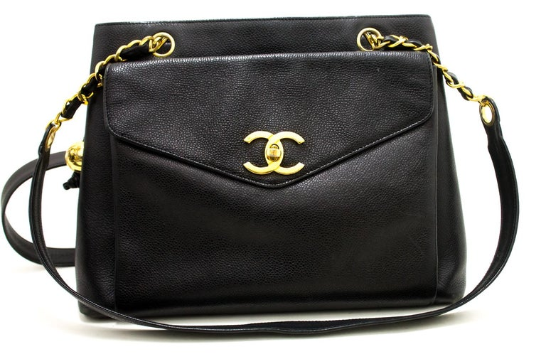 de04aa566a6a An authentic CHANEL Caviar Large Chain Shoulder Bag Black Leather Gold  Hardware. The color is