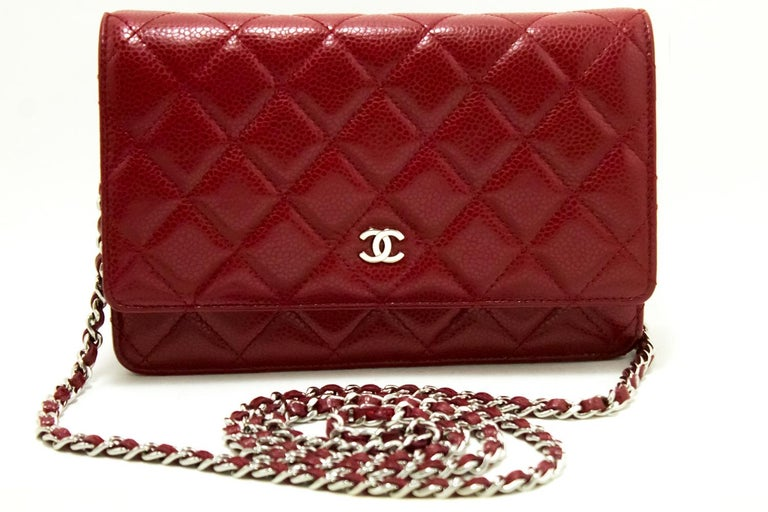 An authentic CHANEL Caviar Red Wallet On Chain WOC Shoulder Bag Crossbody. The color is Red. The outside material is Leather. The pattern is Solid. Conditions & Ratings Outside material: Caviar leather Color: Red Closure: Snap Hardware and chain: