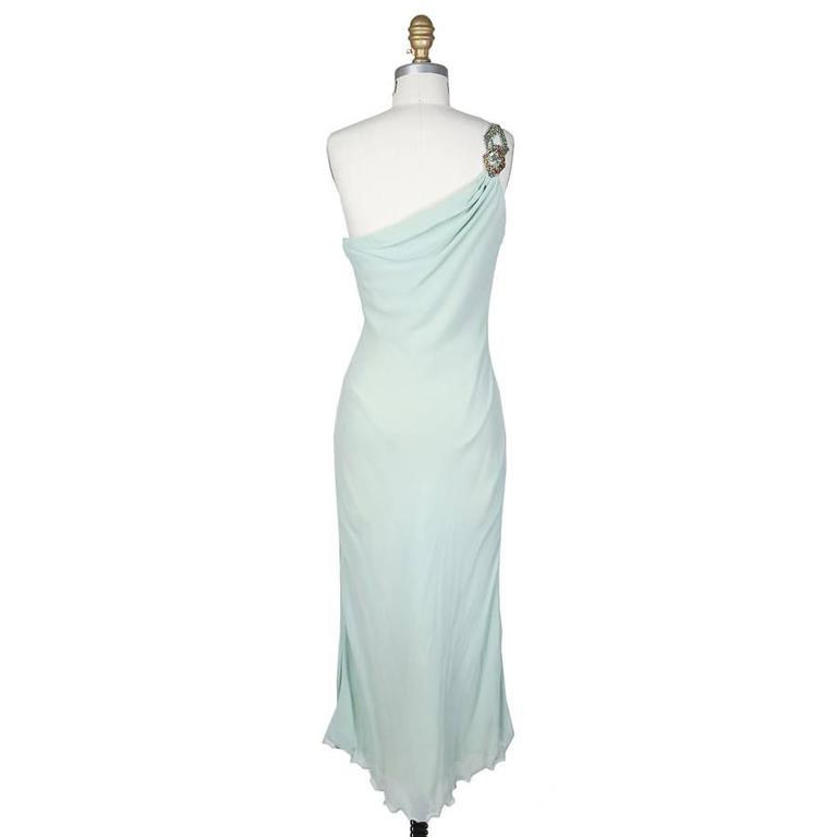 This is a mint green silk dress by Versace Atelier c. late 1980s.  It features a one shoulder embellished strap.