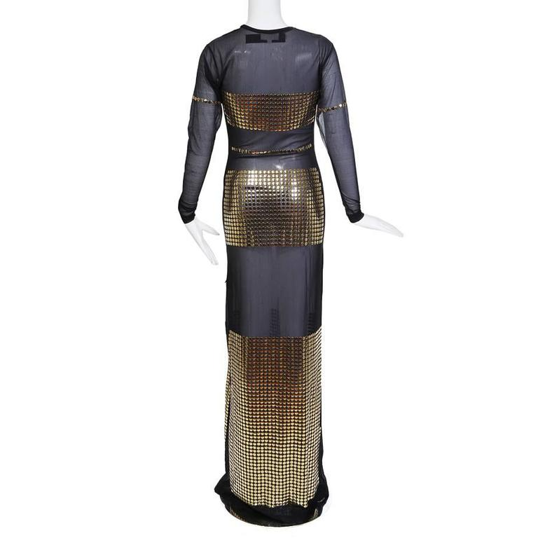 "This is a long sleeve dress by Todd Oldham c. 1990s.  It features a fine black mesh body with panels of gridded gold buttons placed for coverage.    14"" shoulder to shoulder 22"" sleeve length"