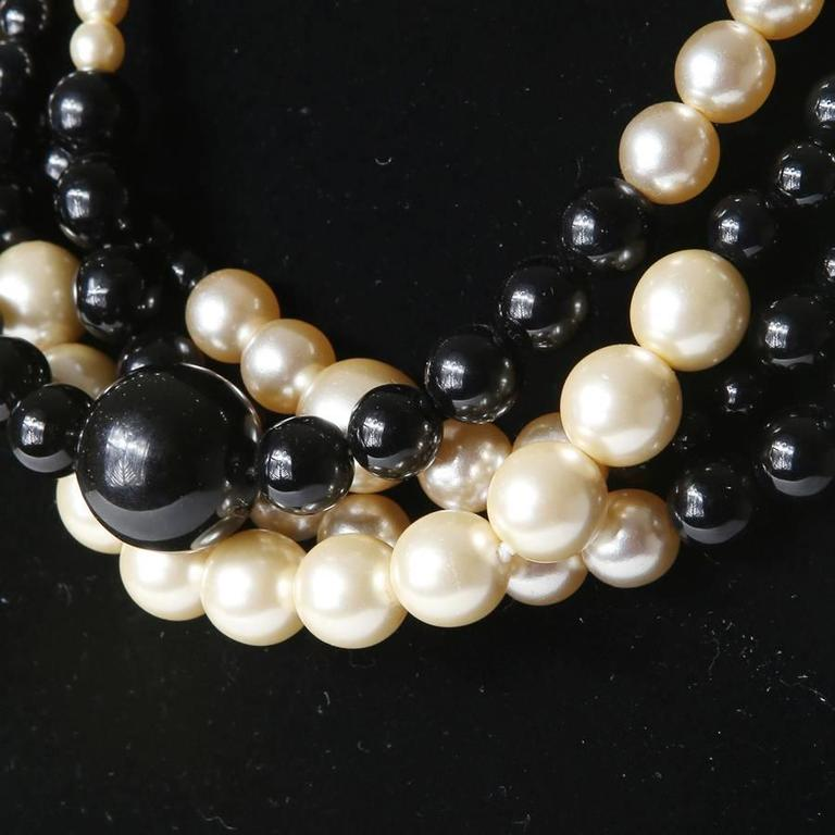 "Necklace strand of black and white pearls by Chanel.  16.5"" circumference"
