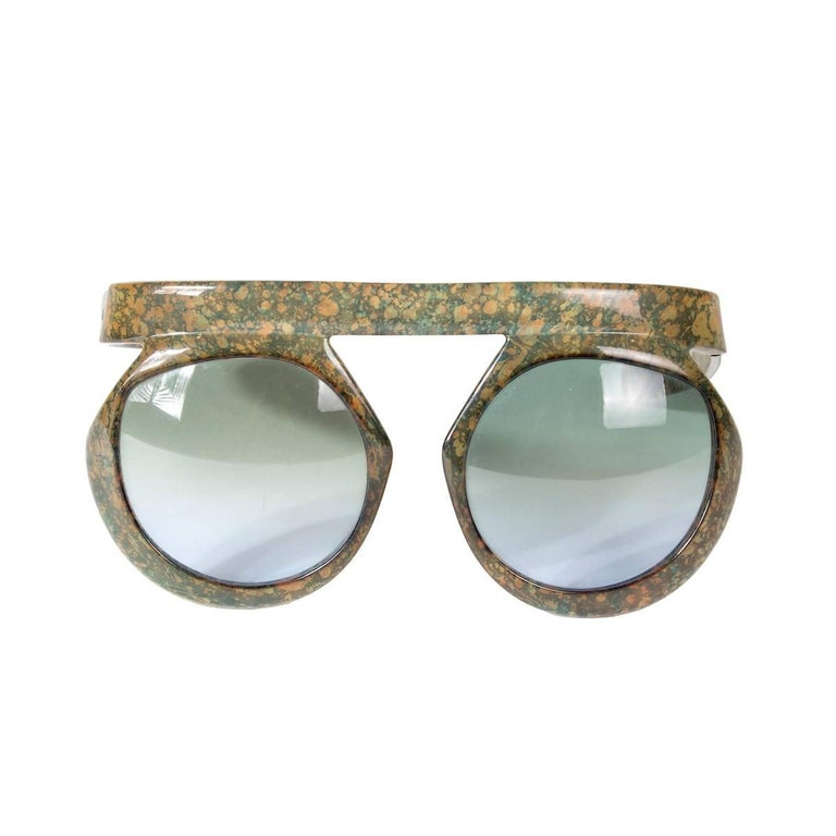 "These are a pair of sunglasses by Christian Dior from the 1970s.  They are called the ""2030"" and were made in Germany.  Rare and collectible set of shades.  5.75"" width of brow bar 6"" width of lens frames 3"" height in front 5"" length of temple arms"