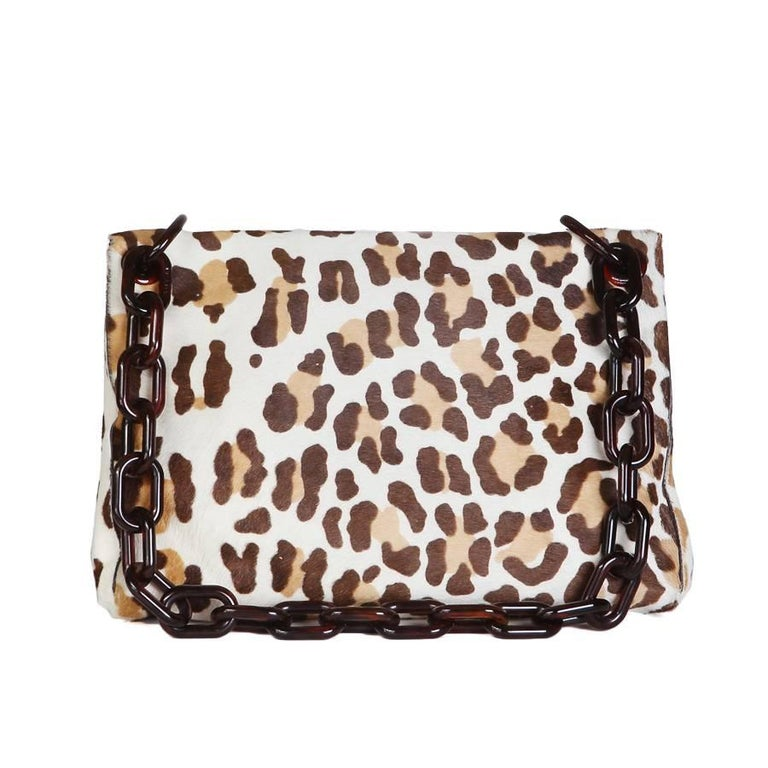 "This is a shoulder bag by Prada.  It features a leopard print of calfhair.  The strap is a dark amber colored lucite chainlink.  Dimensions:  12.5"" x 2.5"" x 8.5"" 11.5"" handle drop"