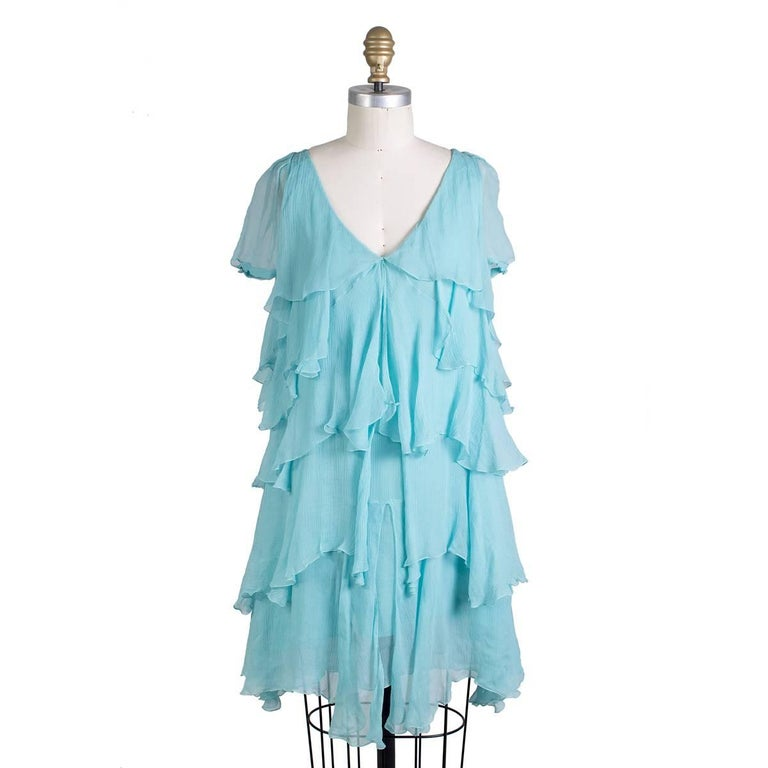 Top from John Galliano featuring silk covered button closures on sleeve and an attached slip lining.  Size 6 38