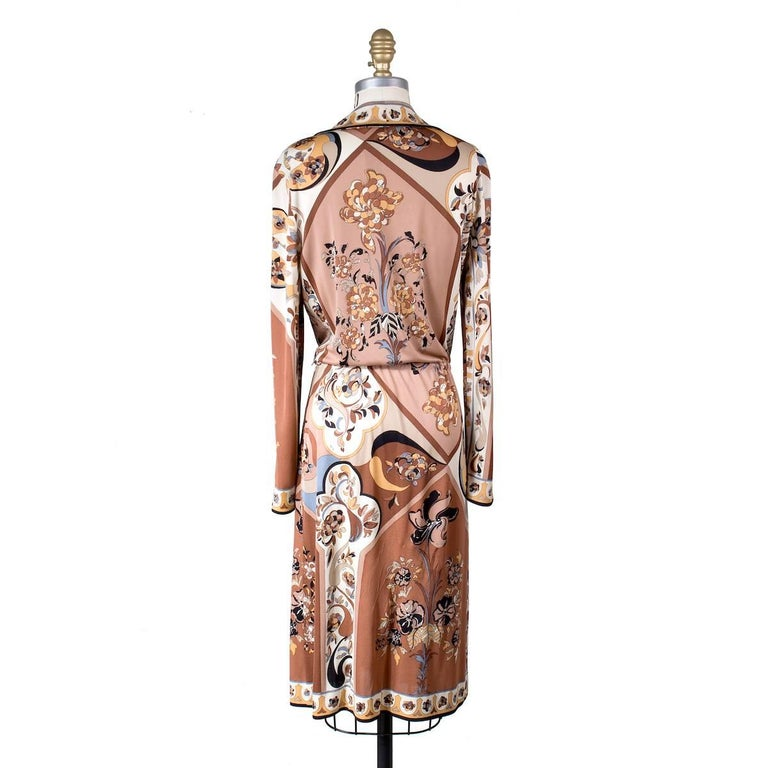This is a vintage Pucci dress circa 1970s.  It features a signature Pucci print in brown and has a drawstring waist to cinch.