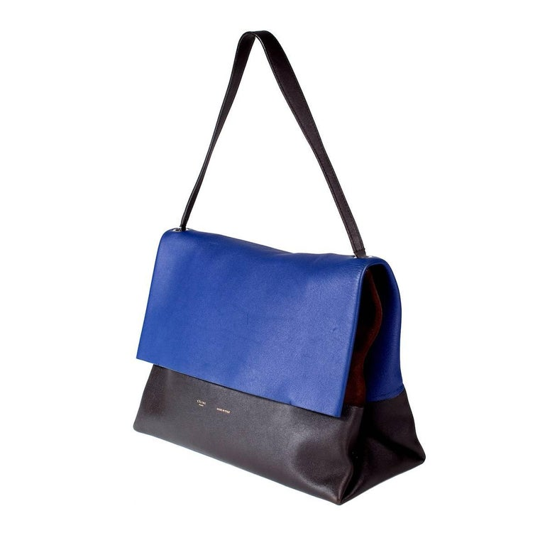 """This is a shoulder bag from Celine. Tri-color leather and suede flap bag with matching pouch wallet.    Bag dimensions:   14"""" x 3.5"""" x 12"""" with a 8.5"""" handle drop Pouch dimensions:  8"""" x 1.75"""" x 6"""""""
