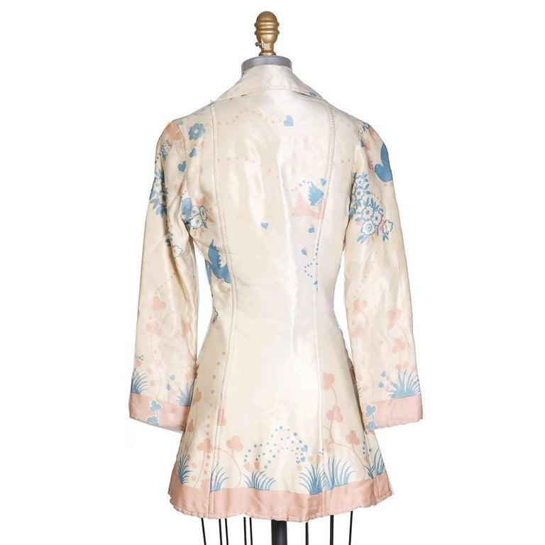 Vintage jacket from Ossie Clark circa 1960s / 1970s.  Quilted silk, floral print, and single breast closure in front.    Size 8 15