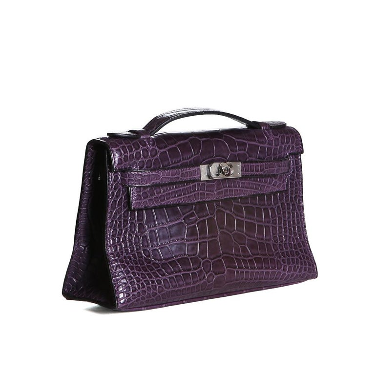 Product Details: Mini Kelly bag by Hermes from 2008 Purple croc skin with silver palladium hardware Kelly style with top handle Dimensions:  8.5