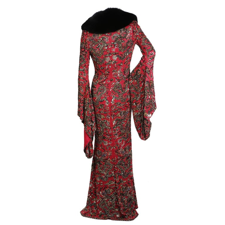 Vintage coat from Escada Ornate beading with fox fur collar Floor length Bell sleeves Red satin lining and button closures down front Condition: Excellent vintage condition Size/Measurements: Size 36 36