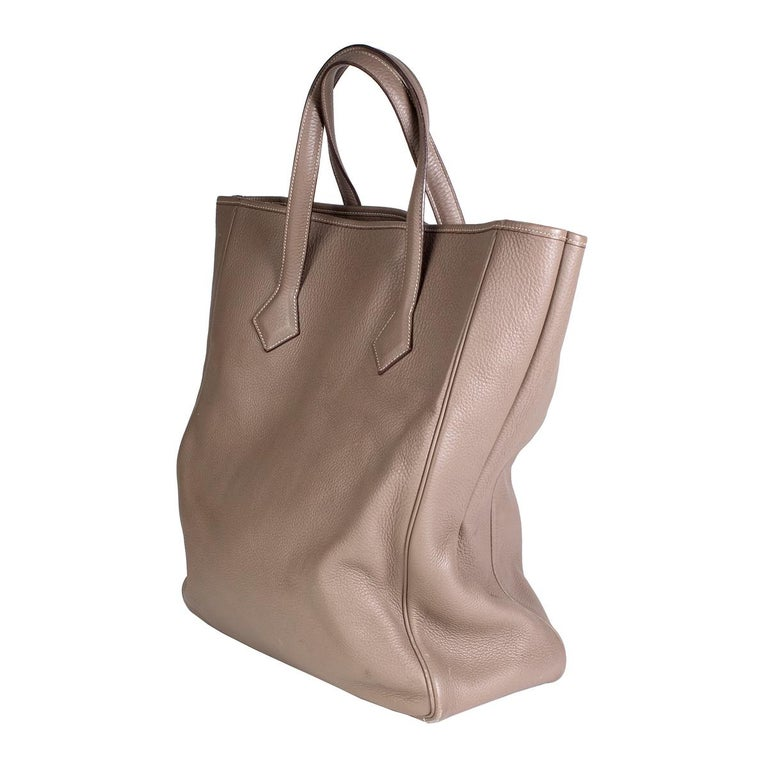 Tote by Hermes Grey togo leather, soft and supple Inside zipper closure pocket White contrast stitching on handles and along top trim Dimensions:  14