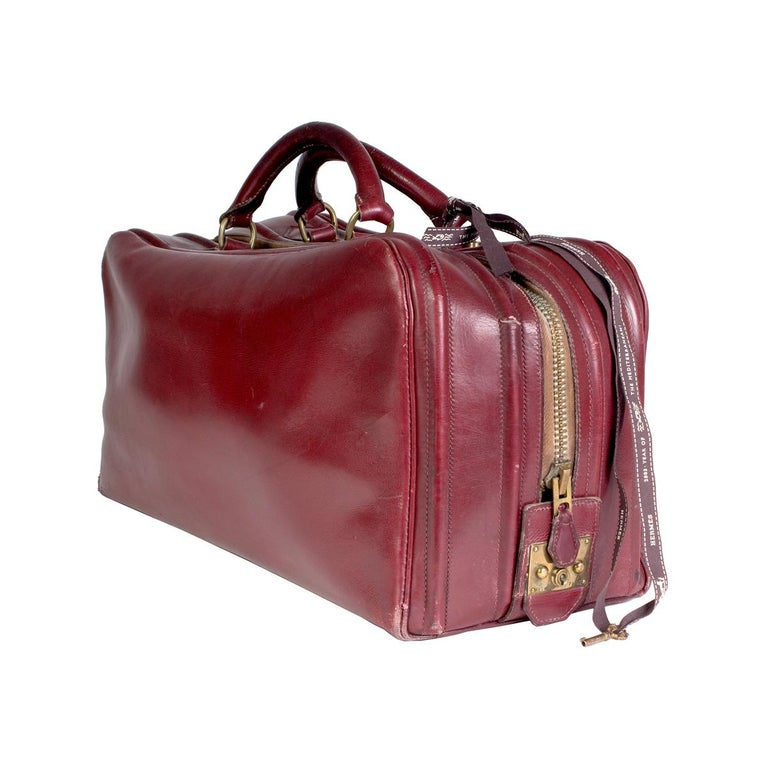 Vintage travel duffle by Hermes Zipper closure along top and side Two top handles Dimensions:  18