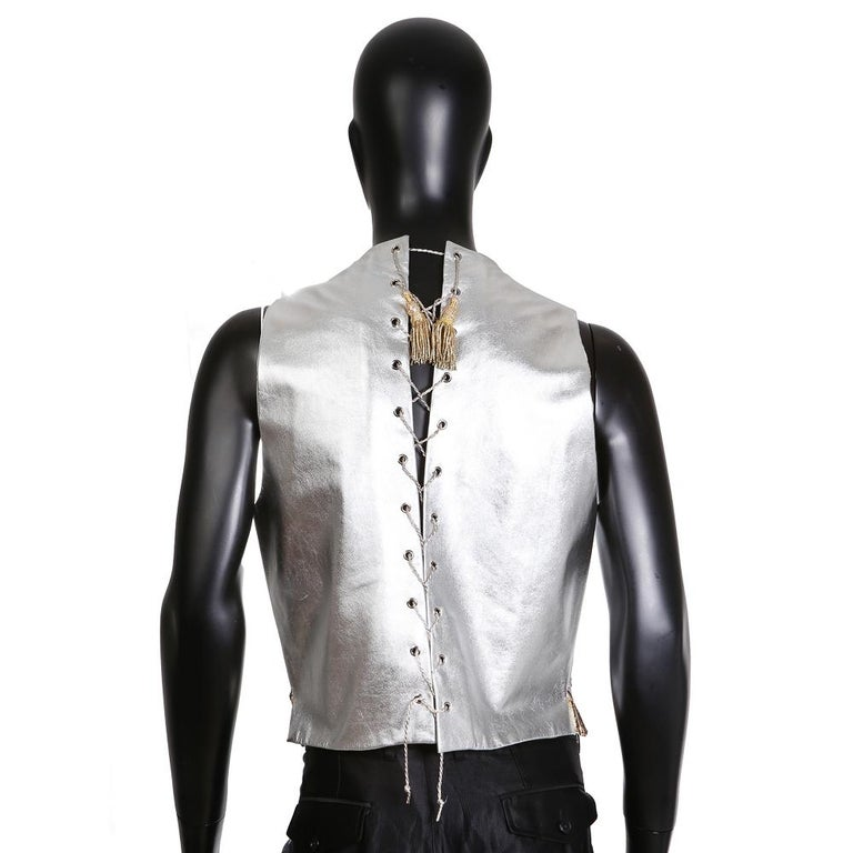 Men's vest from Lesage Silver leather with corset rope braiding detail in back Gold and silver sequined front with sun emblem Condition: Excellent  Size/Measurements: 20.5