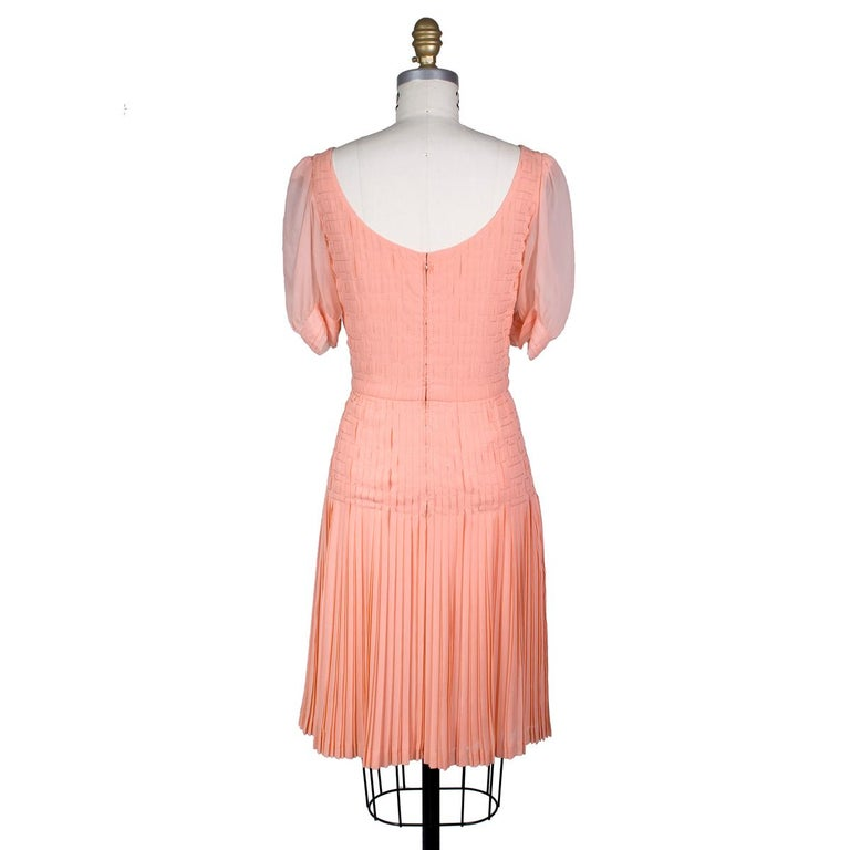 Vintage dress by Coco Chanel Peach pink silk chiffon with stitching and pleating details  Sheer puff style sleeves Condition: Excellent vintage condition  Size/Measurements: 32