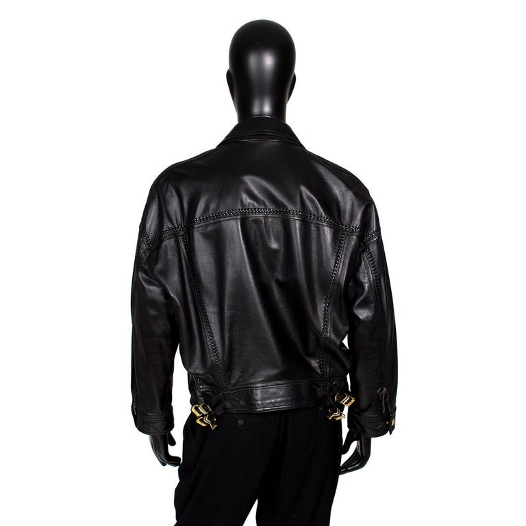 Men's jacket by Gianni Versace from his Bondage Collection, Fall 1992 Black leather with gold hardware buckles Whipstitch details Vintage fit with oversize chest and tapered sleeve Condition: Excellent vintage