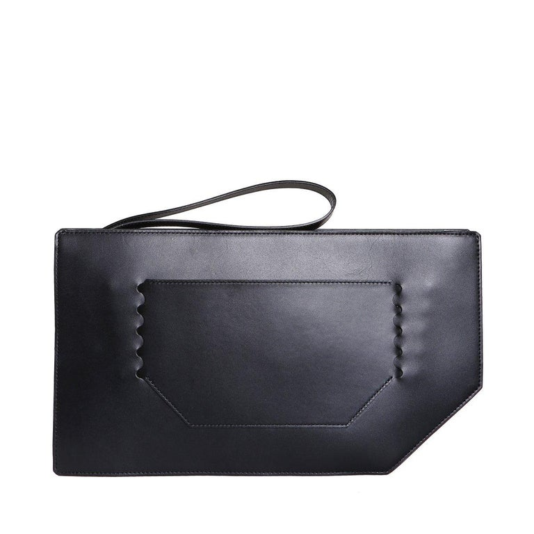 Clutch bag by Issey Miyake Black leather with zipper closure Patterned facade changes between black, white, or gradient with the press of a button! Black suede lining Dimensions:  14.5