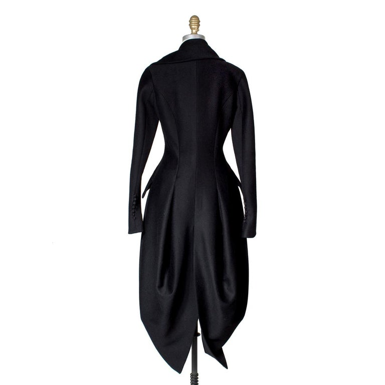 Product Details: Vintage John Galliano coat Asymmetrical lapel collar Tapered arms Sculptural draped hip Large single button closure in front Condition: Excellent  Size/Measurements: Approximate size 4 16