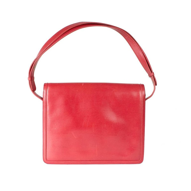 """This is a vintage shoulder bag from Gucci. Features red leather with gold hardware, flap closure, and snaps on straps to do a short or long length for the shoulder strap.  Dimensions:  10"""" x 1.75"""" x 8.5"""""""