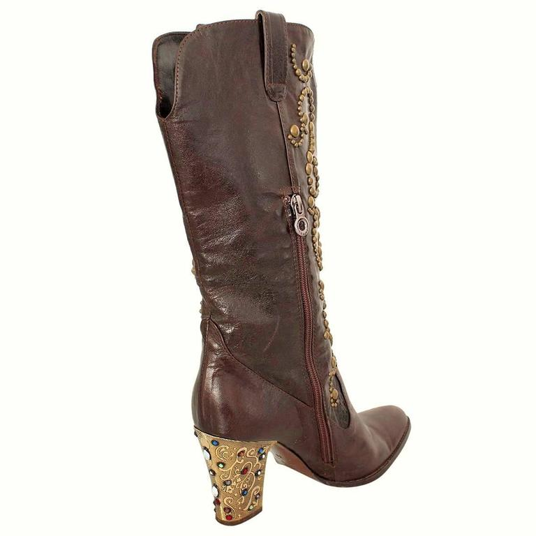 Magnificent boots by italian designer Le Silla Leather Dark brown color Bronze colored studs applicated Magnificent golden heel with colored crystals Heel height cm 8,5 (3.34 inches) Made in Italy Worldwide express shipping included in the