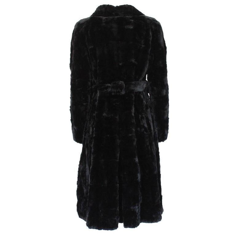 Beautiful Marni fur coat ! Long coat Lapin fur Black color Button closure 2 Pockets With belt Total length cm 100 (39.3 inches) Made in Italy Worldwide express shipping included in the price !