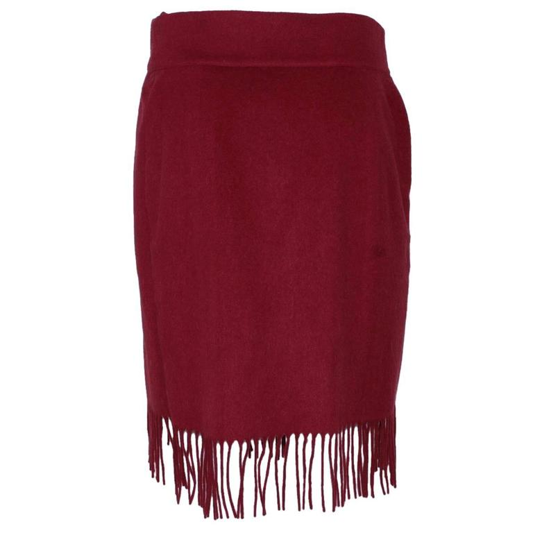 Extremeli beautiful Chanel skirt Wool Golden buttons Cherry colour With frings Total length cm 62 (24.4 inches) French size 36, italian 40 Worldwide express shipping included in the price !