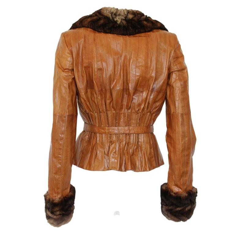 Amazing John Galliano jacket 100% eel Orygon fur Silk lining Honey color 2 button closure Wit belt Total lenght from shoulder cm 48 (18.9 inches) Made in Italy Worldwide express shipping included in the price !