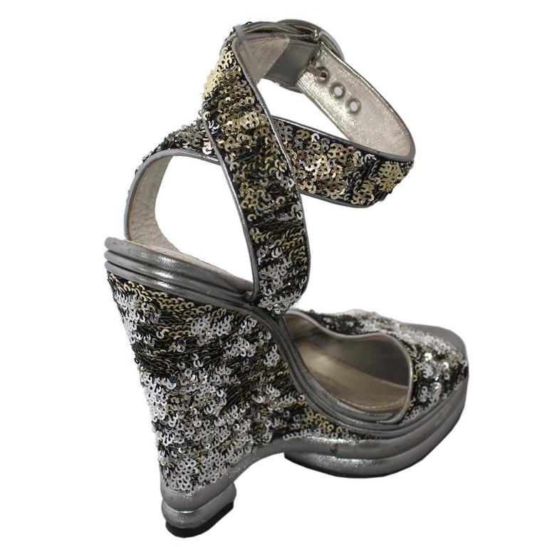 Shiny and super cool Dolce & Gabbana high sandal Sequins Silver color Two buckles Heel height cm 15 (5.9 inches) Plateau height cm 4 (1.57 inches) Made in Italy Worldwide express shipping included in the price !