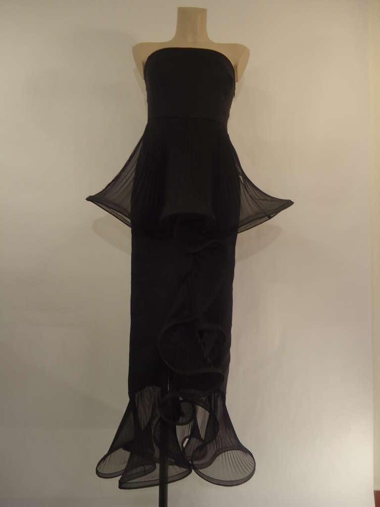 Magnificent evening dress by the king of fashion Giorgio Armani.  1980's vintage black label, Giorgio Armani via Borgonuovo 21 Milano.  100 % silk chiffon Fantastic work of silk chiffon and voile plissé.  Must have !  Black colour Size