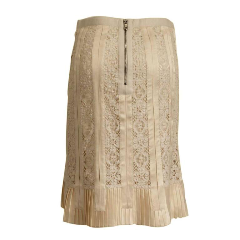 Beautiful and classy Dolce & Gabbana skirt White cream color Cotton and silk (60%) All worked in abeautiful lace and embroidery Plissé silk at the bottom Total lenght cm 58 Italian size 42 (US 6/8) Made in Italy Worldwide express shipping