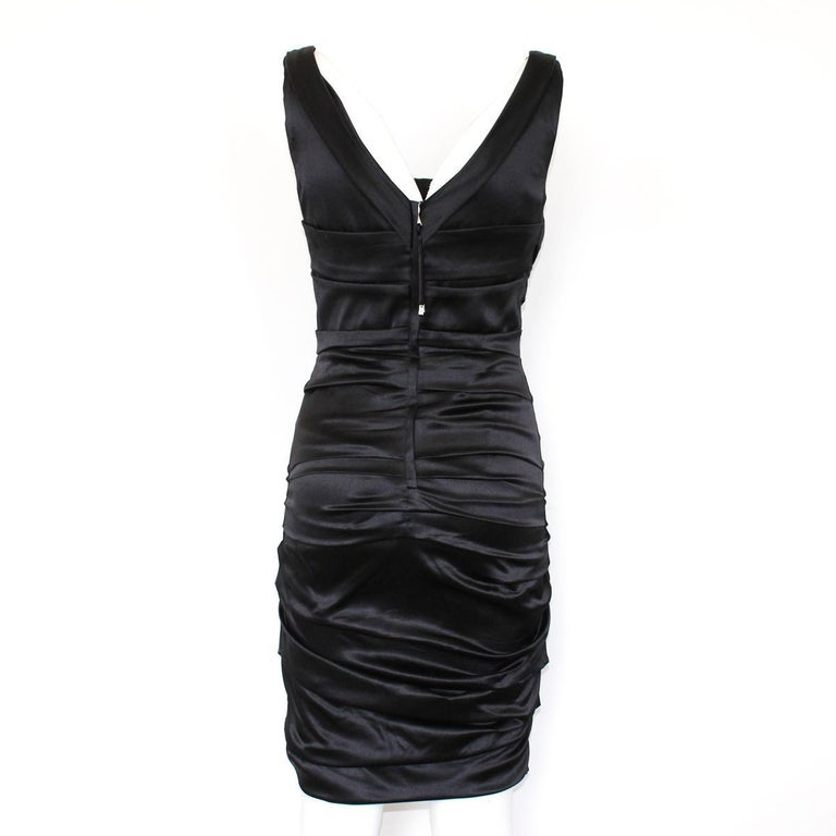 Super chic dress by Dolce & Gabbana Satin Black color Embossed Back zip closure Total lenght from shoulder cm 92 (36.2 inches) Worldwide express shipping included in the price !