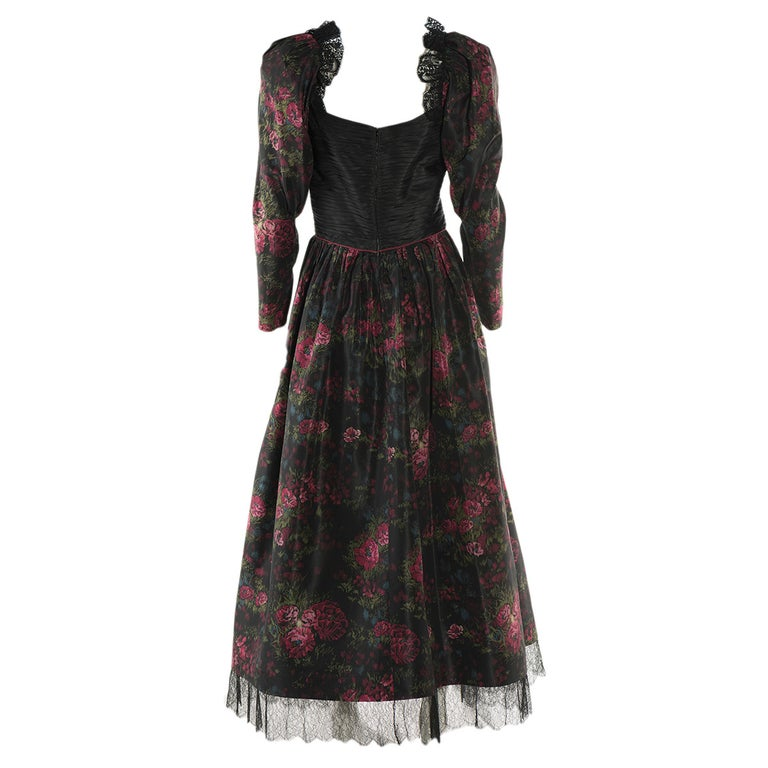 Amazing evening gown by Raffaella Curiel Milano Vintage from the 70's Roses and flower fancy Black, green and fucsia colors Wonderful work of black lace on shoulders and at the bottom Plissé breast Long sleeve Textile Made in Italy Worldwide