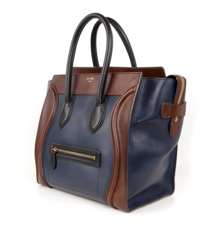 Guaranteed authentic Celine Tri colour medium Phantom luggage tote bag. An iconic beauty in Navy and Brown with Black front zip and handles.  Zip top with 2 interior slot pockets and 1 zip pocket.  1 exterior zip pocket.  4 metal feet. CELINE PARIS
