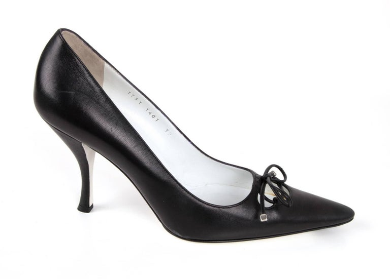 Guaranteed authentic Dolce&Gabbana beautiful black leather pump with key hole and leather tie. The ties ends have silver tips.  Pointed toe and shaped heel.   NEW or NEVER WORN. final sale.    SHOE MEASURES:   INNER SOLE  11