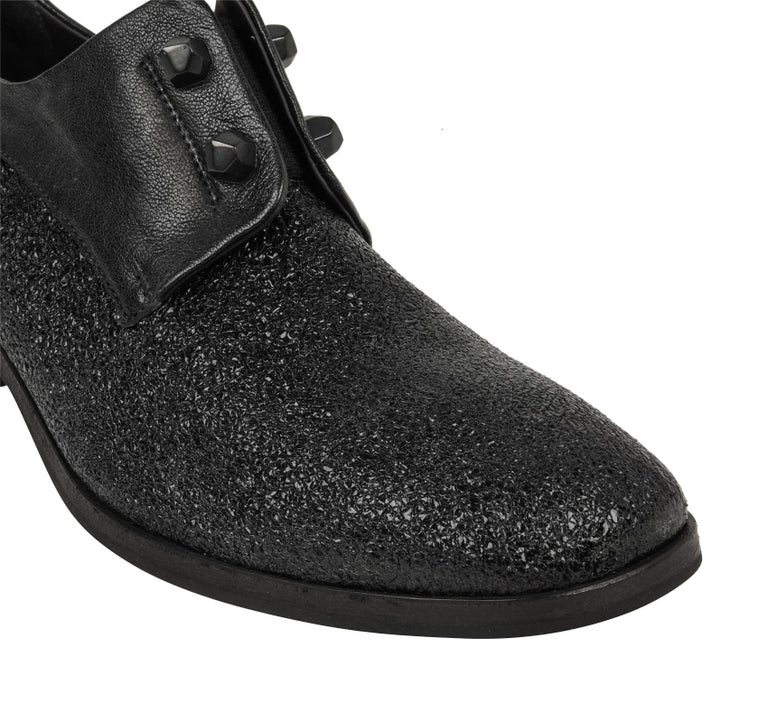 Guaranteed authentic Henry Beguelin high cut shoe in black richly textured leather combined. Rounded toe. Slip on with a block heel for all day comfort.  Faceted leather faux closure hardware. NEW or NEVER WORN  SIZE  39 USA  9  SHOE MEASURES: HEEL