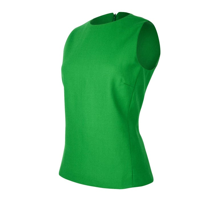 Guaranteed authentic Christian Dior emerald green sleeveless top.  Shaped in a tunic style with jewel neckline and hidden rear zip. No fabric or size tag. final sale  SIZE fits 8  TOP MEASURES:  LENGTH  24.5
