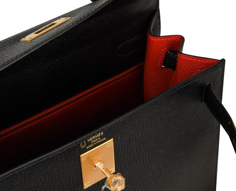 Guaranteed authentic rare chevre leather HSS Hermes Kelly 28 sellier bag with brushed gold hardware. Black with Vermillion red  interior brings drama. Exquisite handbag. Comes with lock, keys, strap, clochette, sleepers, raincoat and signature