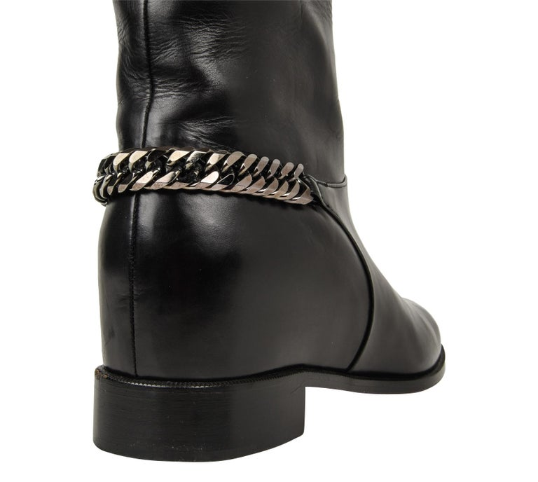c7cba7942c Guaranteed authentic Christian Louboutin flat black leather knee high cate  boots. Boot has hematite colored