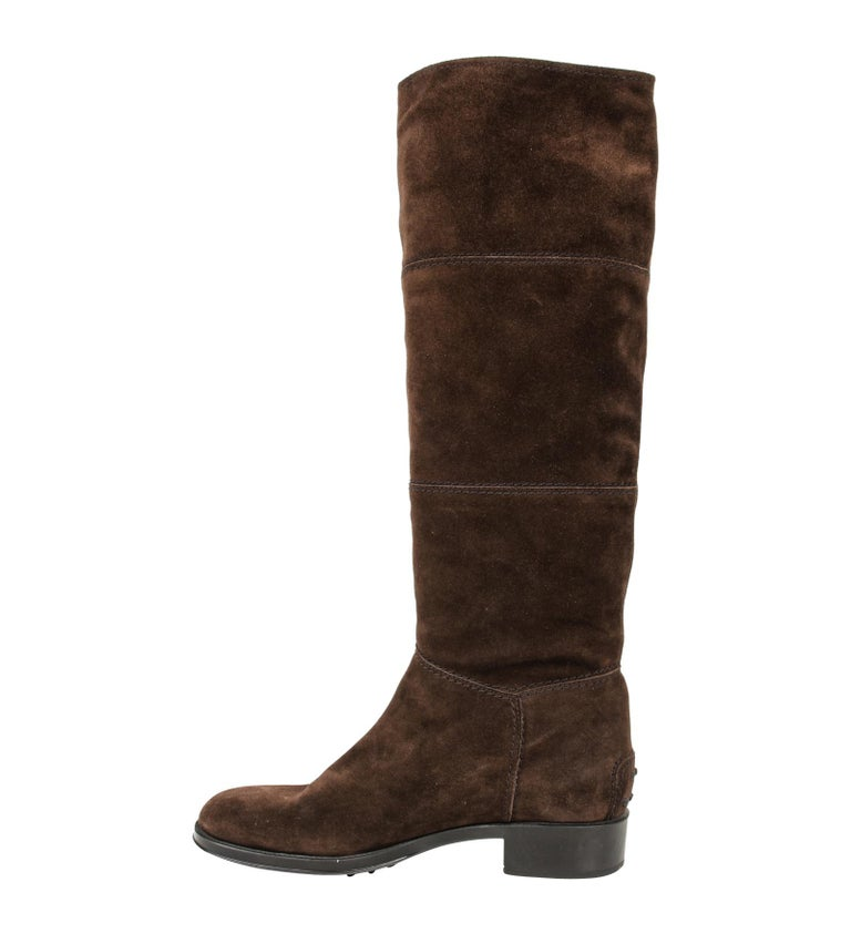 Guaranteed authentic Tod's brown suede flat boot with stitch detail. Boot has Tod's signature driving heel protector.  Boot pulls on.  NEW or NEVER WORN final sale  BOOT SIZE:  38.5 USA SIZE  8.5  BOOT MEASURES:  HEEL  1.25