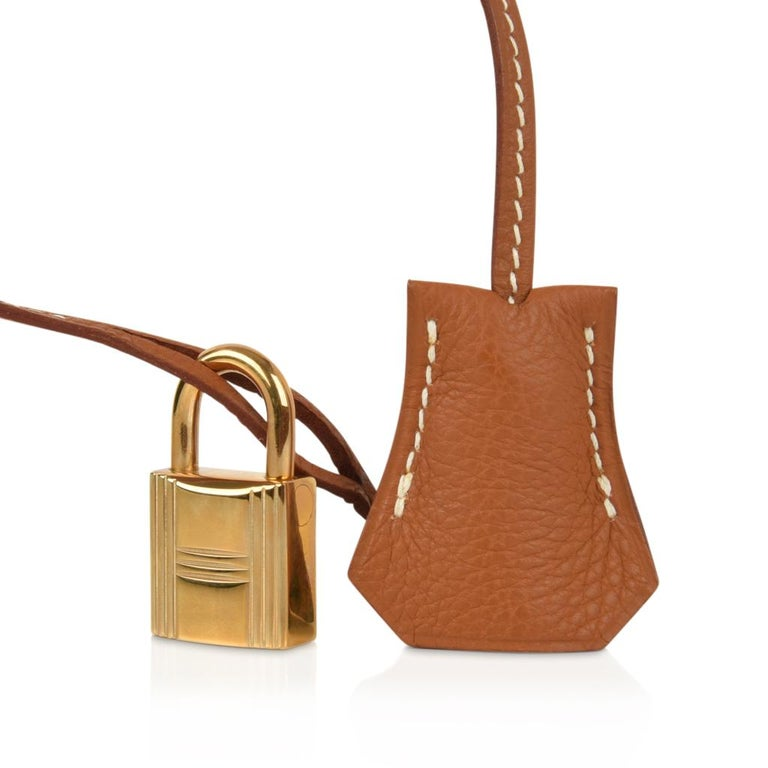 Guaranteed authentic  Hermes Birkin 35 bag featured in iconic Gold.     Ultimate classic in togo leather.    Lush with gold hardware.      Comes with lock, keys, clochette, sleepers, raincoat and signature Hermes box. NEW or NEVER WORN final