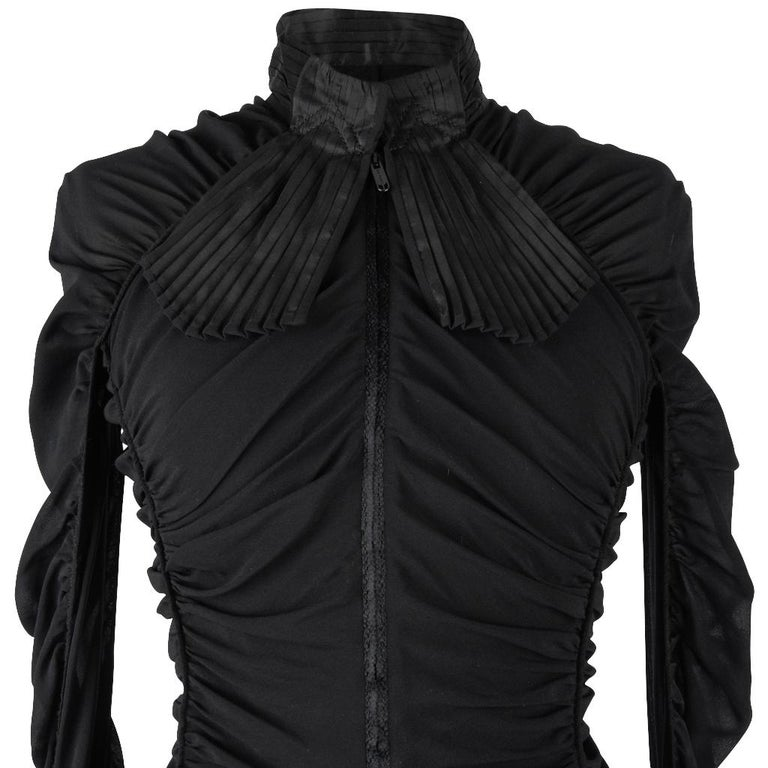 Guaranteed authentic Zac Posen fabulous zip front top. Long sleeve mandarin collar. Collar and french cuffs are accordion pleated taffeta with pleated fabric attached to collar that sort of looks like wide ties. Cuffs have 3 working black ball cuff