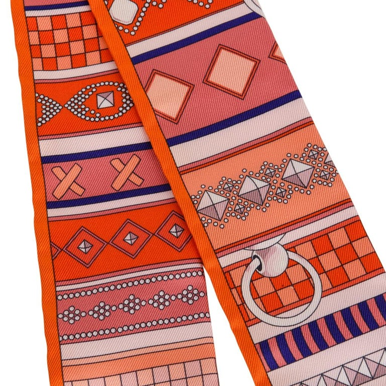 Guaranteed authentic Hermes Twilly silk scarf Colliers de Chiens. Pretty Orange colorway. Comes with signature Hermes box. NEW or NEVER WORN Shop online at mightychic for your Hermes accessories and a seamless shopping experience. final sale  SIZE