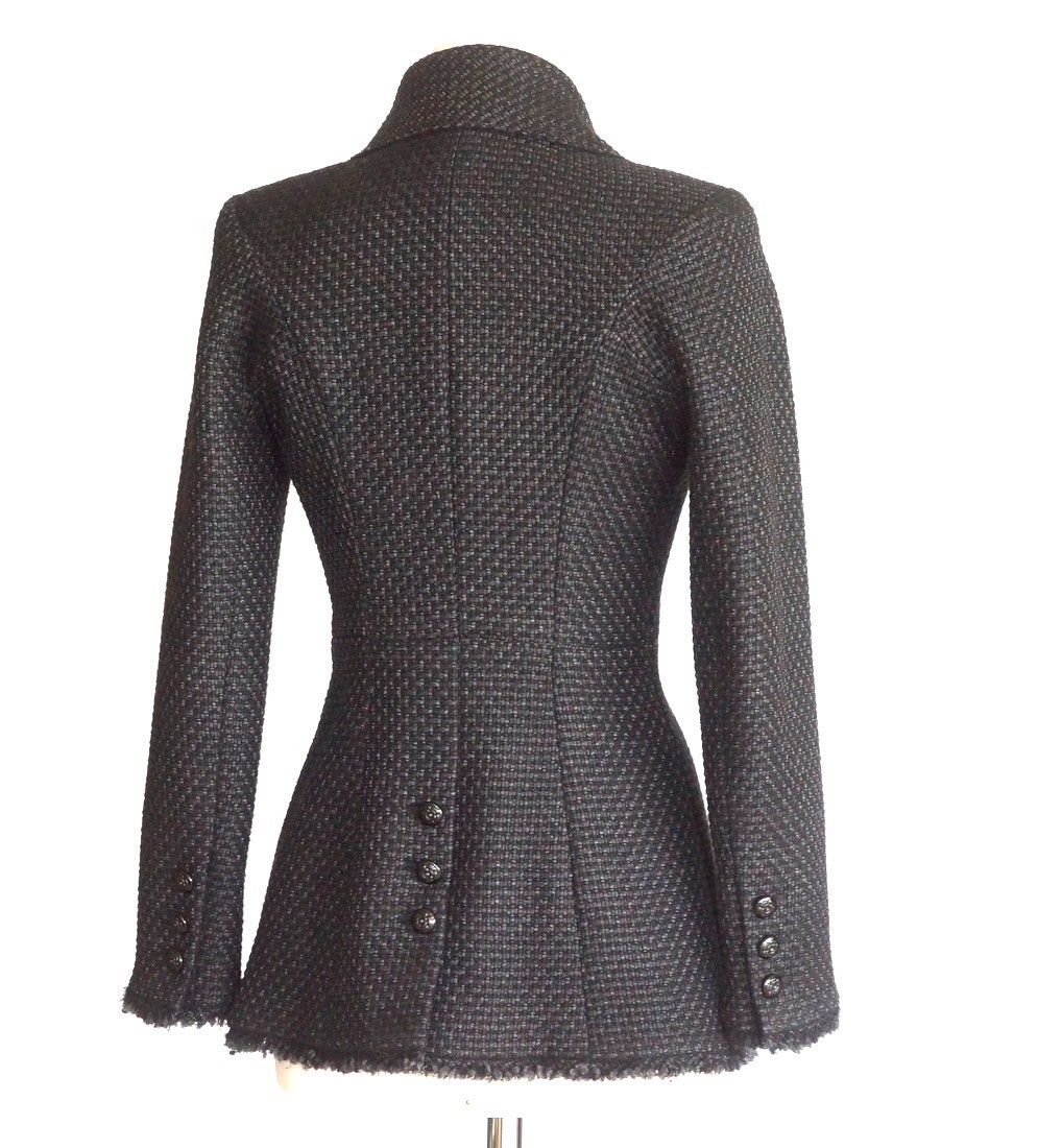 Guaranteed authentic CHANEL exquisitely shaped and detailed black tweed jacket.  