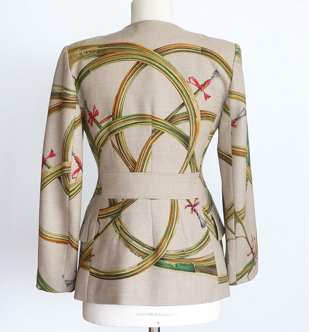 Guaranteed authentic Hermes Trompes De Chasse collectible beautifully shaped military styled scarf print jacket.    Burlap coloured background with trumpets and flourishes in muted shades of gold, green, orange and pink ribbon. 2 front flap