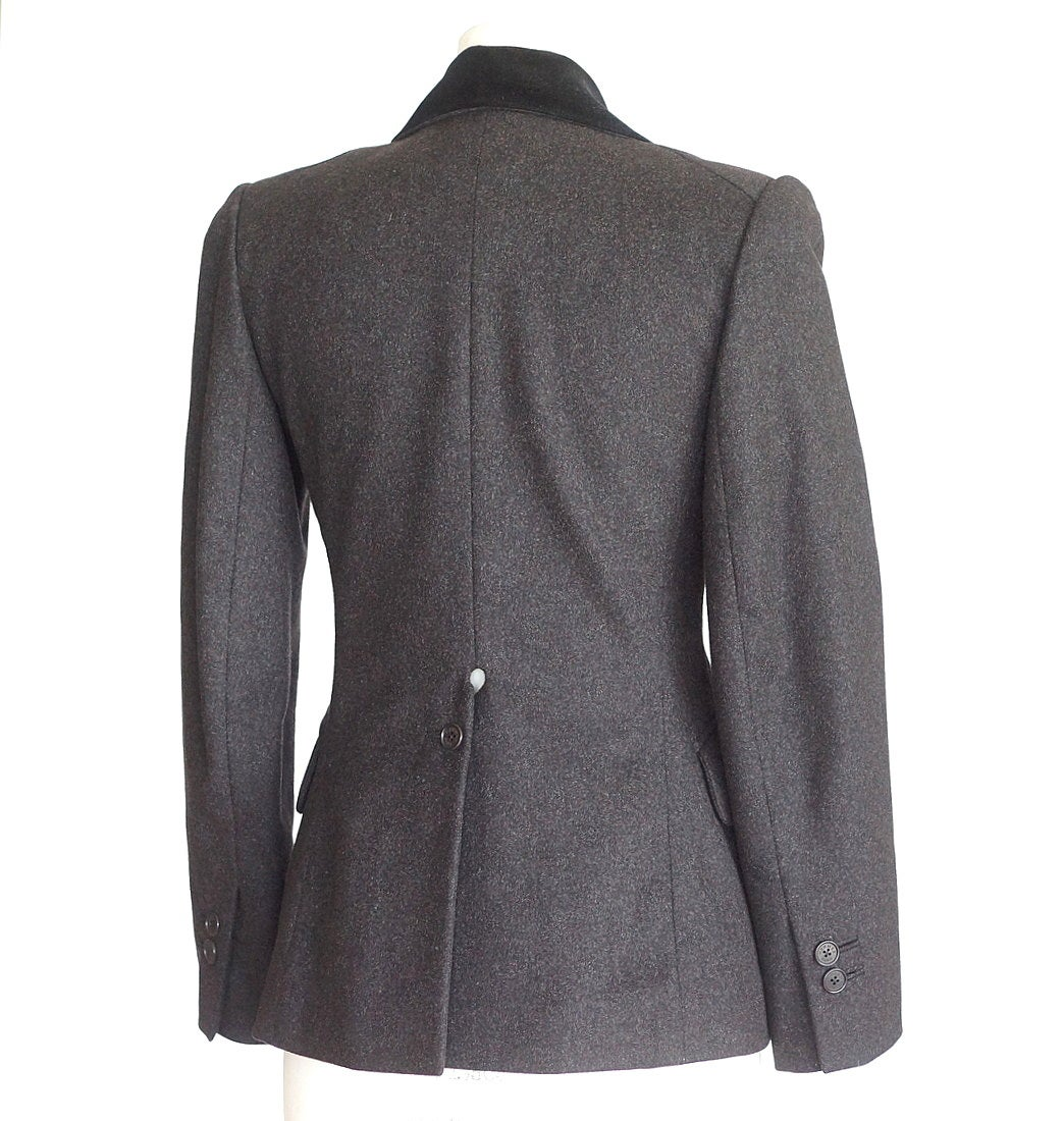 Guaranteed authentic Hermes 3 button single breast vintage rich charcoal gray jacket with beautiful shaping.   Velvet collar in black. 2 flap pockets and 1 breast pocket. Rear has a unique vent with single working button and keyhole. Beautifully